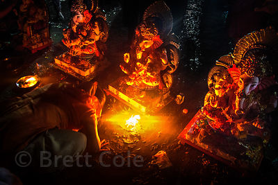 A family prays to a Ganesh idol on Chowpatty Beach in Mumbai, India, during the Ganesh Chaturthi festival.