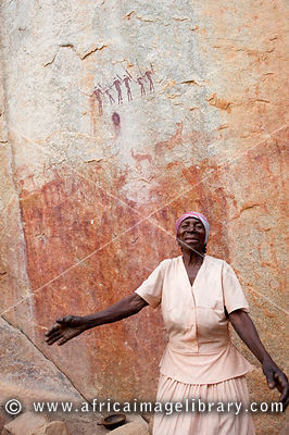 Woman dancing in front of the sacred Chinamapere rock-art near Manica ...