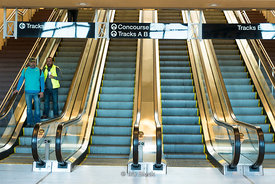 Commuters get down the escalator at Frank R Lautenberg Rail Station - Secaucus Junction in New Jersey.