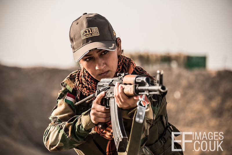 PAK (Kurdistan Freedom Party) female fighter during a training session at her base north of Hawija, where Kurdish Iranian fighters are holding the line against the last vestiges of Daesh and preparing to engage the Hashd al Shaabi forces threatening Kirkuk. Kirkuk Governorate, Iraq, 14th October 2017