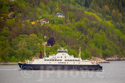 Hardingen Ferry leaving the Village of Utne in Norway