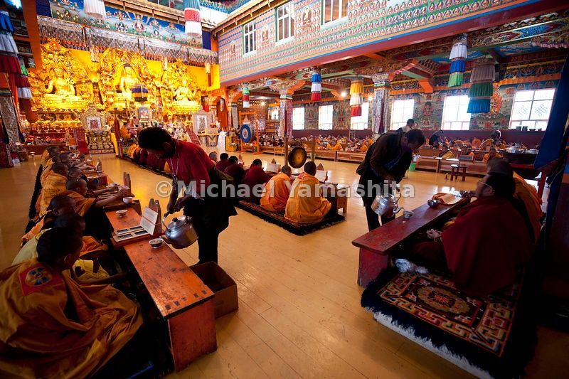 Pelyul Monastery monks drinking tea. One of the richest, thanks to the gold mines in the area. Newly rebuilt main hall has modern lighting unlike the dimly lit.monasteries we've been photographing. Home to 3 Rinpoches, living Buddhas.....................................