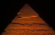 Pyramid of Khafre with limestone covering at the summit lit up at night, Pyramids of Giza, Cairo, Egypt