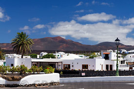 The village of Yaiza with the volcanoes of Timanfaya National Park in the distance, Lanzarote, Spain.