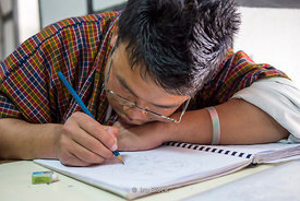 A student studying at Institute of Thirteen Arts and Crafts in Paro, Bhutan.