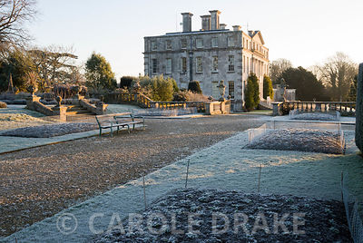 The terrace garden in the winter with beds protected by chicken wire from marauding deer and rabbits. Kingston Maurward Gardens, Dorchester. Dorset, UK