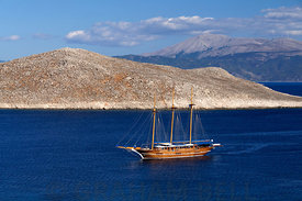 Three masted wooden sailing ship, between Ftenaghia anf Nissos Islet, Chalki Island, near Rhodes, Dodecanese Islands, Greece.