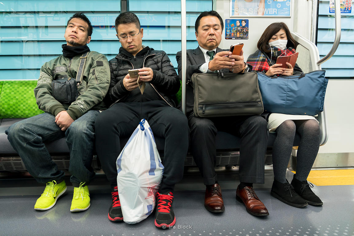 Commuters in a subway car in Tokyo, Japan.