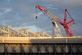 Cranes and construction at Heathrow Airport in London, UK.