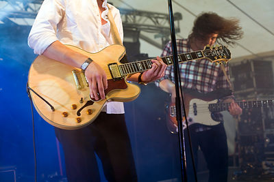UK - Standon - A guitarist plays on stage at the Standon Calling Festival