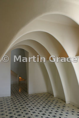 Attic of Gaudi-designed Casa Batllo apartment building in Barcelona, showing bricked-up parabolic vault, plastered and painted