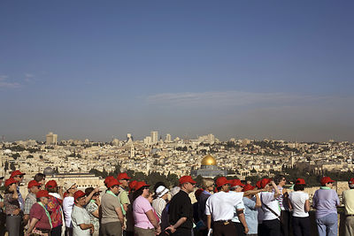 Israel - Jerusalem - Tourists photograph the Old City as seen from the Mount of Olives