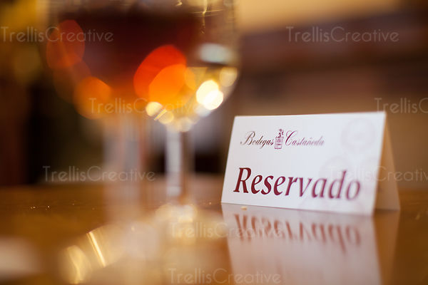 Reserved card on wooden table in restaurant