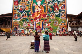 People in front of Thongdrel (giant applique scroll) of the Zhabdrung in Punakha Dzong, Bhutan.