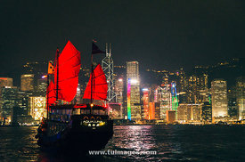 traditional chinese junk cruise in victoria harbour of hong kong