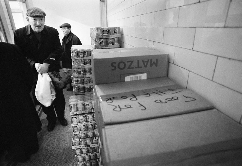 UK - London - An elderly man leaves the Food for the Jewish Poor soup kitchen with his weekly provisions.