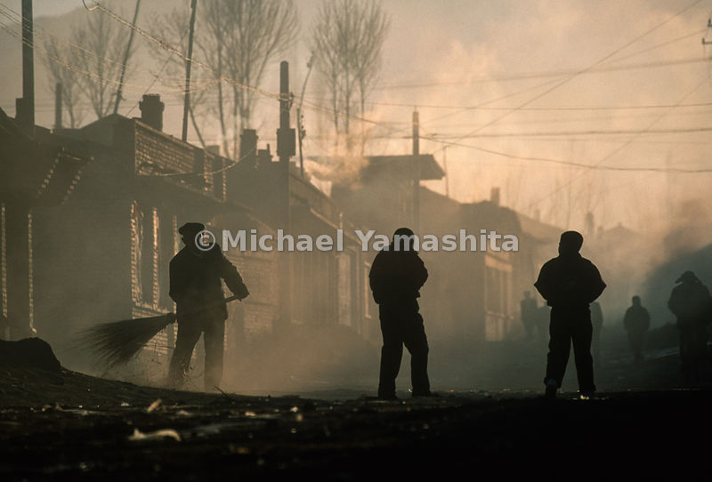 Town is clouded by coal smoke. Washaoling, Gansu, China