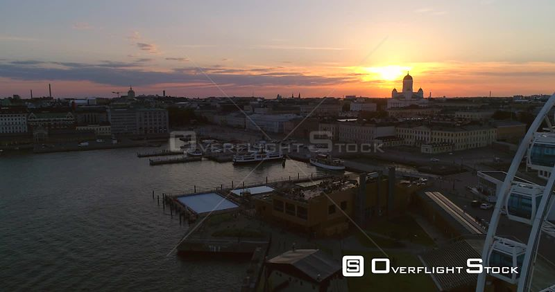 Market Square, Aerial View Bypassing the Helsinki Skywheel, at the South Harbour, on a Sunny Summer Evening Dusk, in Helsinki, Uusimaa, Finland