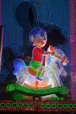 Illuminated LED animatronic figures on display in Gariahat, Kolkata, India, during the Durga Puja festival.