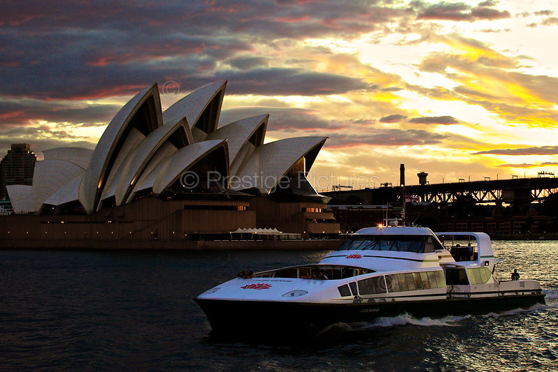 Sydney Ferries Supercat passing by The Sydney Opera House at Sunset