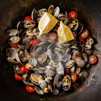 Vongole Shells Clams with tomato and parsley in pan close-up