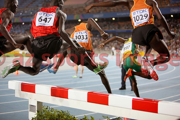 (1033) Benjamin Kiplagat (647) Brimin Kiprop Kipruto going over the lake at the 3000m Steeplechase