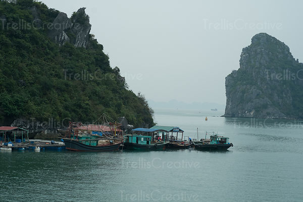 Floating moored boats in Halong Bay, Vietnam