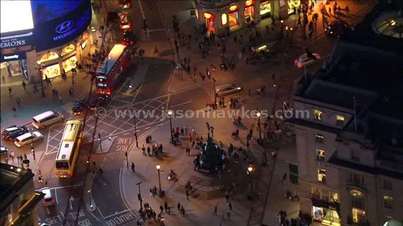 Aerial footage around Piccadilly Circus at night, London, England, UK