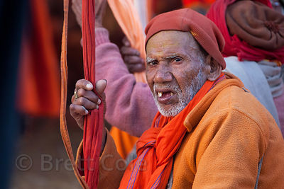 Sadhus assemble in a large tent to receive dinner en masse, at the 2013 Kumbh Mela, Allahabad, India.