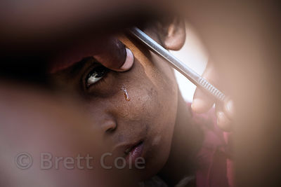A boy gets a shave on Dashashwamedh Ghat, Varanasi, India.