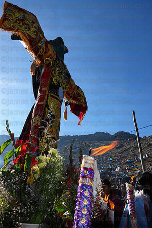 Burning candles at the last cross on the pilgrimage trail, Qoyllur Riti festival, Peru
