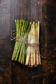 Fresh raw Green and White asparagus on wooden background