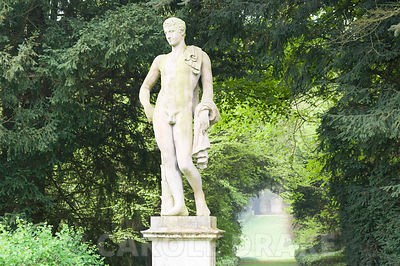 Statue of Apollo with the Long Walk stretching behind him, part of Charles Bridgeman's original garden scheme. Rousham House, Bicester, Oxon, UK