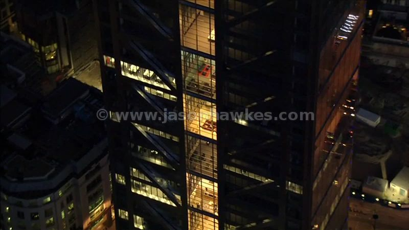Aerial footage of the Heron Tower at night, City of London, England, UK