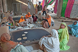 Women prepare langar (communal meal ) for the crowd during the holla mohalla festival.