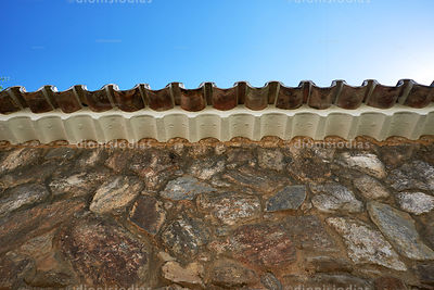 Colonial Roofed Eaves on Stone Wall.