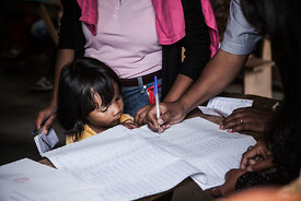 A little girl in a polling station during the 2nd round of presidential and legislative election on December 20th, 2013 in Antananarivo.