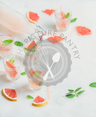 Cold refreshing alcohol cocktail with fresh grapefruit, marble background