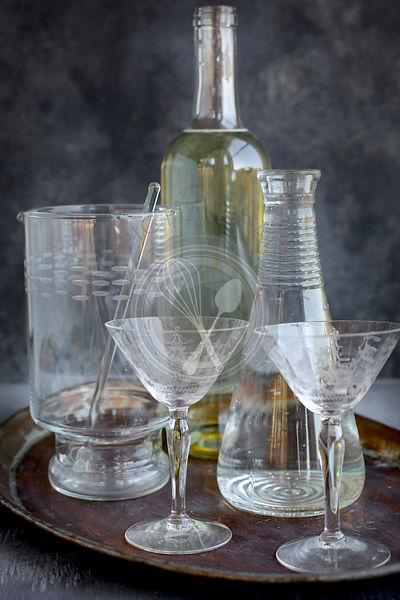 Glasswear for a wine cocktail. Photographed from front view on a grey background.