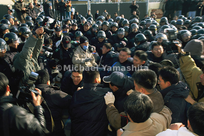 South Korean protestors charge the gates of Camp Casey, a U.S. Army base.