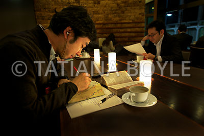 Man studying at a coffee shop