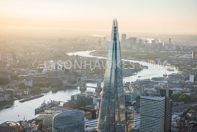 Aerial view of London close up of The Shard with Tower Bridge.