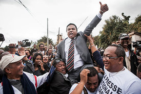 Managing director of the newspaper Madagascar Matin Jean-Luc Rahaga (C) is lifted by supporters after his release from Antanimoro Prison in Antananarivo on July 25, 2014. A justice court in Antananarivo ordered the release of two journalists jailed since Monday for having published a reader's letter accusing members of the Madagascan government of being implicated in illegal rosewood trafficking.