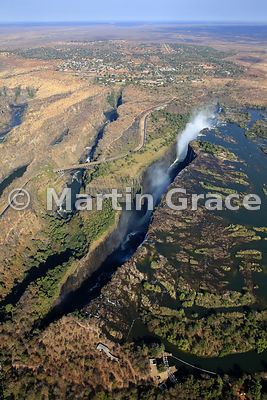 Victoria Falls (Mosi-oa-Tunya) from the air, Zimbabwe and Zambia, with the town of Victoria Falls (Zimbabwe) above