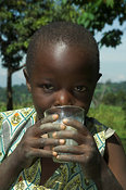 Young African girl drinking milk from glass Kenya Africa