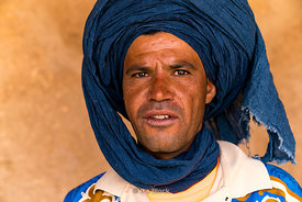 Portrait of a local in the Moroccan village of Khamila, founded in the 1950's near Erg Chebbi, Sand dunes area of the Sahara in Morocco