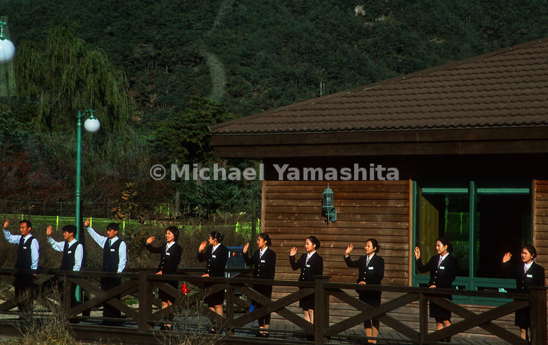 Staff at the Mt Kumgang waving to tourist. North Korea.