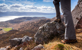 A hiker surveying the route ahead of them. Sron a Garbh Choire Bhig with Loch Linnhe in the distance.