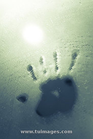 hand print on glass