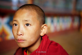 A young monk at Paro Dzong in Paro District, Bhutan.